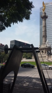 The Monumento a la Independencia, with a modern sculpture in the foreground.