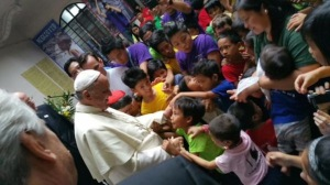 Pope Francis breaks protocol to spend precious 15 minutes with street children under the care of a Tulay ng Kabataan (Bridge of the Youth) center in Intramuros, right after celebrating mass at the Manila Cathedral, Jan 16, 2015.